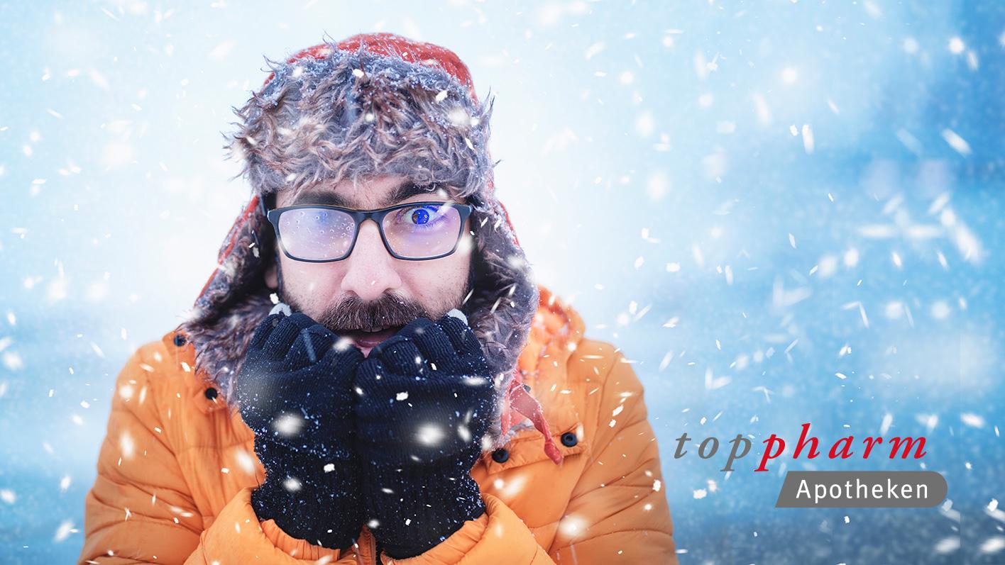 TopPharm Apotheke / Weihnachten / Grippe und Erkältung / Mann in der Kälte